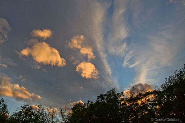 evening light, setting sun reflecting on clouds