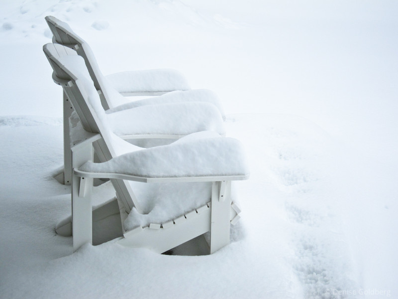 chairs filled with snow