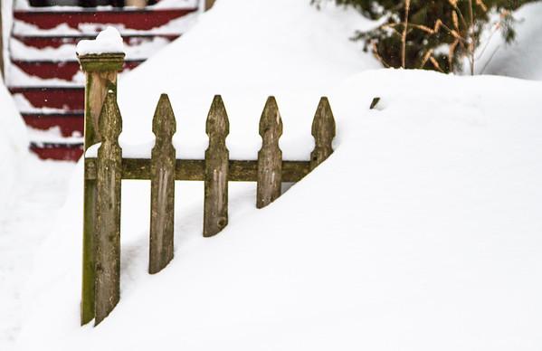 snow against a fence