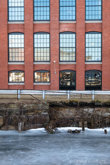 mill building in Lawrence, frozen canal