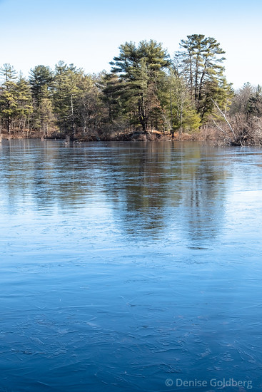 a frozen Stearns Pond in Harold Parker State Forest