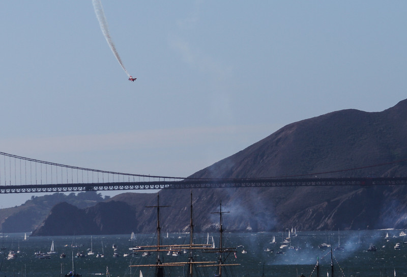 The show began with a red biplane which performed many loops and stunts over San Francisco Bay.  You can see the Golden Gate Bridge in the background