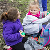 RACHEL LEATHE/ THE COURIER<br /> <br /> 032616 A father helps his kids throw leftover plastic Easter eggs into a bin after the Wapello County Family Treatment Court Easter Eggs Hunt on Saturday morning at Wildwood Park in Ottumwa.