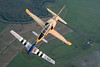 "Stallion 51's L-39 Albatross leads ""Crazy Horse"", a TF-51 Mustang over the central Florida farmlands."