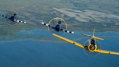 """Stallion 51's T-6 Texan leads the two TF-51's """"Crazy Horse"""" and """"Crazy Horse 2"""""""
