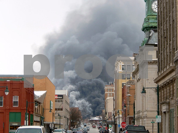 -Messenger photo by Brandon L. Summers<br /> <br /> Smoke seen from Central Avenue, at Fourth Street.