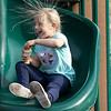 The good weather on Tuesday, March 10, 2020 brought many out to have fun at Parkhill Park in Fitchburg. Lillian Dimarzio, 6, of Fitchburg had fun playing on the playground equipment at the park. Here she blows some bubbles while sliding down the slide. SENTINEL & ENTERPRISE/JOHN LOVE