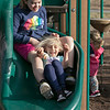 The good weather on Tuesday, March 10, 2020 brought many out to have fun at Parkhill Park in Fitchburg. Lillian Dimarzio, 6, of Fitchburg and her cousin Riley DeGroot, 10, enjoy the slide together during the near 70 degree day. SENTINEL & ENTERPRISE/JOHN LOVE