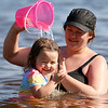 Many were out at Freeman Lake at Varney Park in Chelmsford on Monday as the temperatures got to 90 plus. Having some fun in the water is Aliviana Miele, 2, and her mom Samantha Jamieson, both from Chelmsford. SUN/JOHN LOVE
