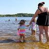 Many were out at Freeman Lake at Varney Park in Chelmsford on Monday as the temperatures got to 90 plus. Trying to stay cool is Samantha Jamieson and her daughters Aliviana Miele, 2 holding her hand, and Avery Miele, 5, of Chelmsford just in front of them. SUN/JOHN LOVE
