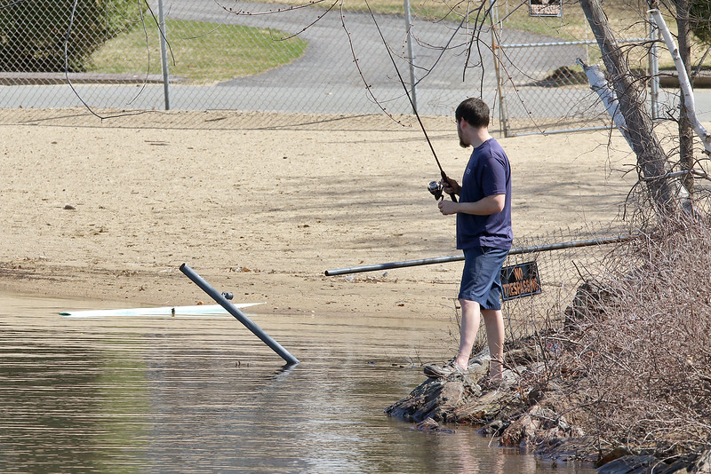 Neftali Vega from Leominster was looking to catch some bass at lake Whalom in Lunenburg on Tuesday during the 80+ temperature. SENTINEL & ENTERPRISE/JOHN LOVE
