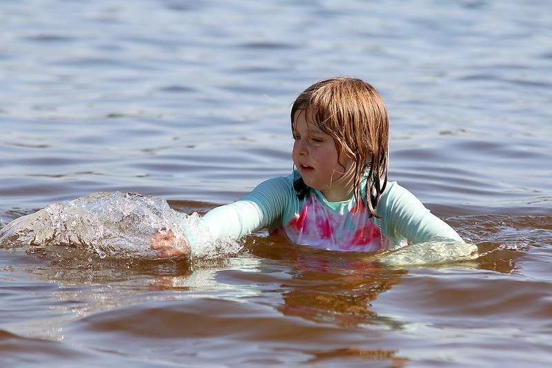 Many were out at Freeman Lake at Varney Park in Chelmsford on Monday as the temperatures got to 90 plus. Having some fun in the water as she tries to stay cool is Avery Miele, 5, from Chelmsford. SUN/JOHN LOVE