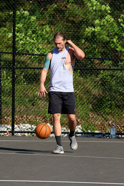 Many were out at Freeman Lake at Varney Park in Chelmsford on Monday as the temperatures got to 90 plus. Playing some basketball at the park during the warm weather is Phil Massa, 28, of Chelmsford. SUN/JOHN LOVE