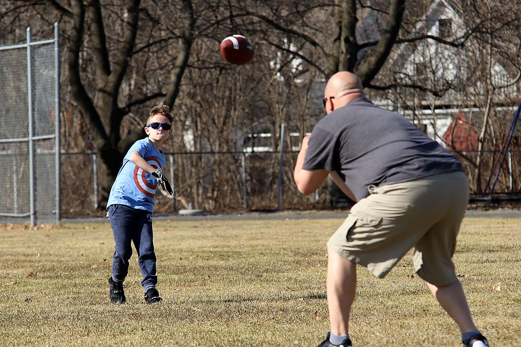 . Brian Scurio played some catch with his son Nico, 8, at Doyle Field in Leominster on Wednesday afternoon as the temperatures got into the 70\'s, February 21, 2018. SENTINEL & ENTERPRISE/JOHN LOVE