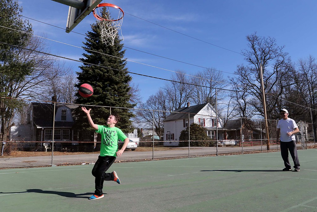 . Tom Thelin and his grandson Brayden Fairbanks, 10, play some basketball at Wallis Park in Lunenburg on Wednesday afternoon as the temperatures got into the 70\'s, February 21, 2018. SENTINEL & ENTERPRISE/JOHN LOVE