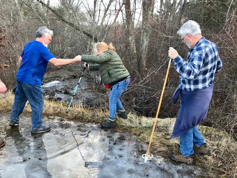 Winter walkers helped each other over the ice spots during Hike Beautiful Billerica's Jan. 11 walk. Photo by Mary Leach