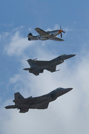 Warplane-F22 Raptor, a Mustang (1951) and a F16 during Miramar air show in San Diego,California on October 03, 2010.