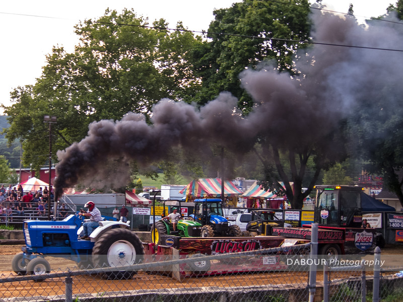 Contestant smokes em up at the Warren County Farmers Fair Tractor Pull 2012