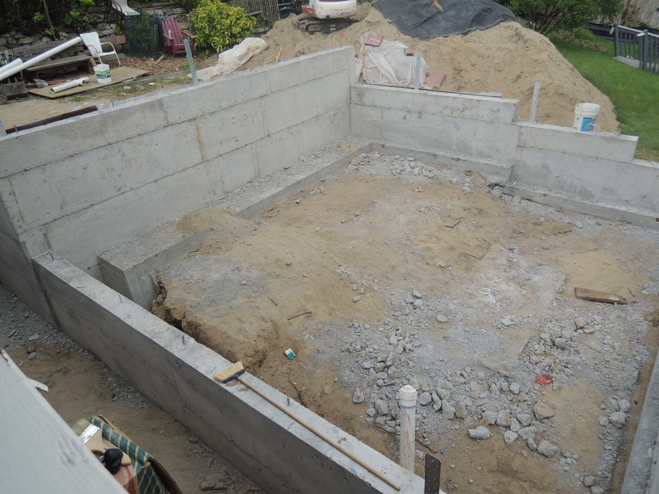 Forms off, concrete hard and continuing to cure.