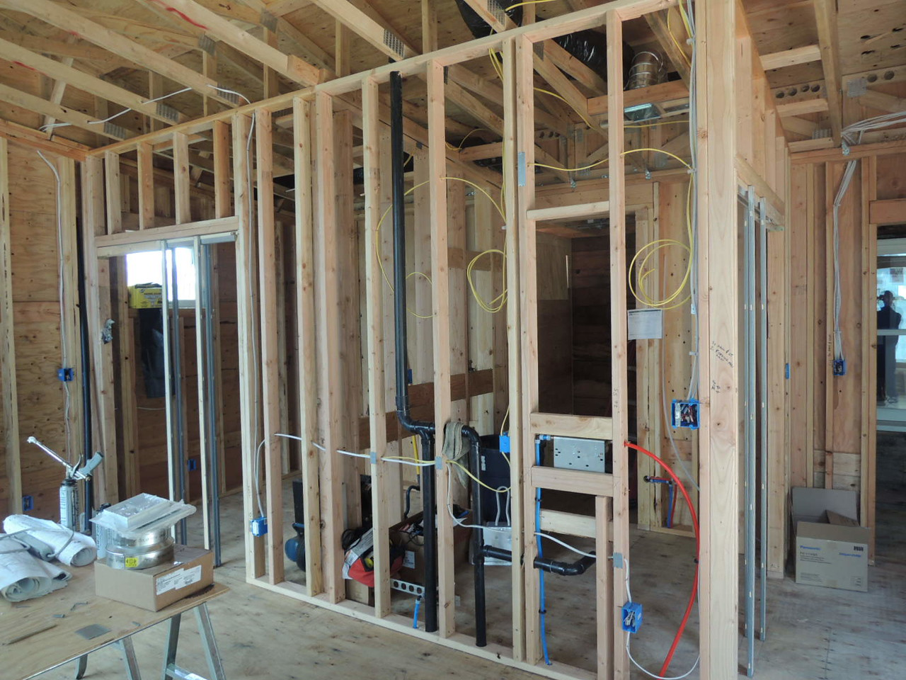 Master bedroom and bathroom framed up, plumbing and electrical roughed in.