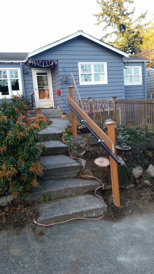 The difficult front steps lacked a handrail, 75 years after the house was built.  I had to wait until the contractor was done moving the Bobcat in an out before fixing this problem - by then, 3 of our friends had taken falls.  <br /> <br /> Problem solved!