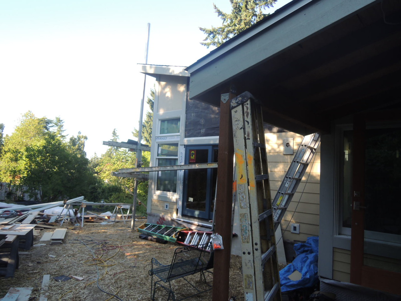 Siding is going on.  Looks like a construction site, doesn't it?