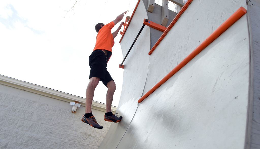 . Instructor, Mike Wilson, jumps up to the top of the wall. Warrior Playground is the Workout of the Week. For more photos, go to www.dailycamera.com. Cliff Grassmick / Staff Photographer/ April 8, 2017