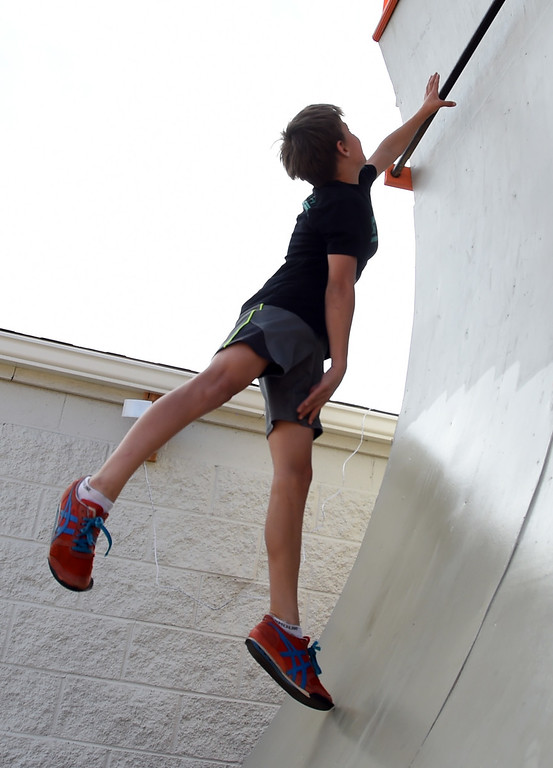 . Jase Hendrichs, 13, runs up the ninja ramp and grabs a hand hold during the workout. Warrior Playground is the Workout of the Week. For more photos, go to www.dailycamera.com. Cliff Grassmick / Staff Photographer/ April 8, 2017