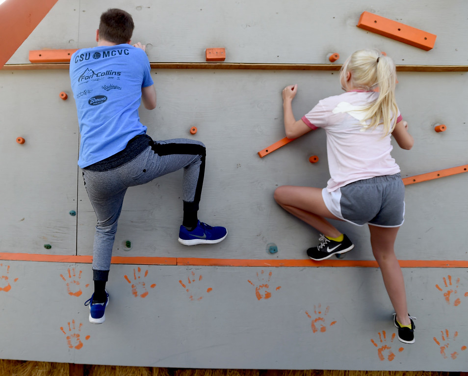 . Jacob Gover, left, and his sister, Amanda, take on the climbing wall. Warrior Playground is the Workout of the Week. For more photos, go to www.dailycamera.com. Cliff Grassmick / Staff Photographer/ April 8, 2017