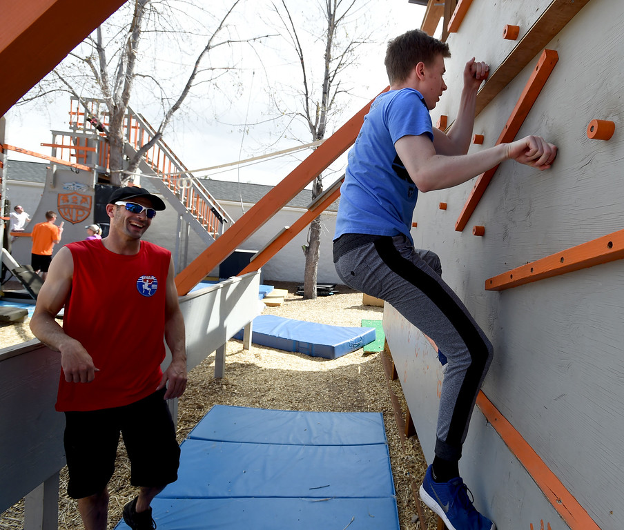 . Instructor, Sam Banola, gives help to Jacob Gover.  Warrior Playground is the Workout of the Week. For more photos, go to www.dailycamera.com. Cliff Grassmick / Staff Photographer/ April 8, 2017