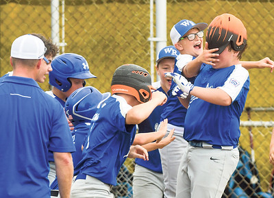 Warrior Run's Brayden Gower get mobbed by teammates after hitting a home run against Orwigsburg during the sectional championship in Selinsgrove on Saturday.