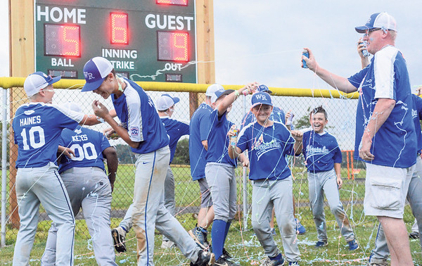 The Warrior Run All-Stars shoot each other with aerosol string after defeating Orwigsburg 9-5 on Wednesday.