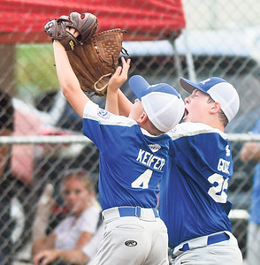 Warrior Run's James Keifer and Brayden Gower both go for a fly ball during Wednesday's sectional championship in Selinsgrove.
