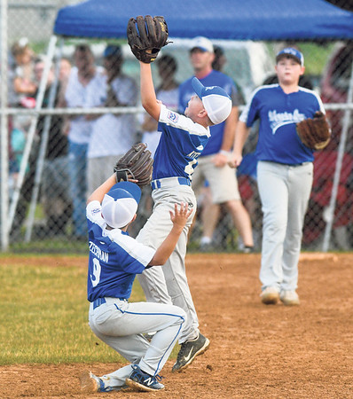 Warrior Run's James Keifer makes a catch in front of teammate, Cohen Zechmn, during Wednesday's sectional championship against Orwigsburg.