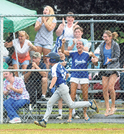 Warrior Run's Tyler Ulrich runs the bases in front of screaming fans after hitting a go-ahead home run against Orwigsburg on Wednesday.