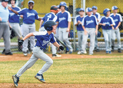 Warrior Run's Tyler Ulrich yells while rounding the bases after hitting a go-ahead home run against Orwigsburg on Wednesday.