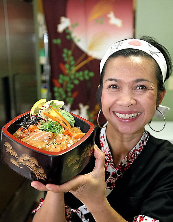 . Kae Bailes holds up a Sake Don lunch special at her Wasabi Tapas in Capitola\'s Brown Ranch Marketplace. (Dan  Coyro -- Santa Cruz Sentinel)