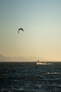 kite surfing jump in the sea at sunset