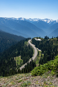 bend in the road up to hurricane ridge through the mountains
