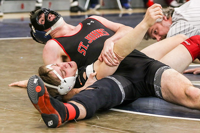 Steven Wentz (top) of St. John's College High School in Washington takes first place by defeating Joseph Siedlarz (second place) of Bishop Ireton High School in Alexandria by a fall.