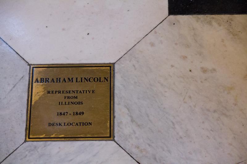 Plaque denoting location of Lincoln's desk in original House of Representatives chamber.