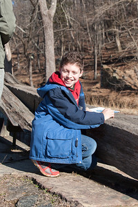 Using one of the lever arms of Lock 18  to work on the Junior Ranger booklet -- Great Falls Park, Maryland, Dec 2013