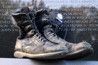 The boots of a fallen soldier at the Vietnam Wall - Washington, DC ... October 22, 2006 ... Photo by Rob Page III