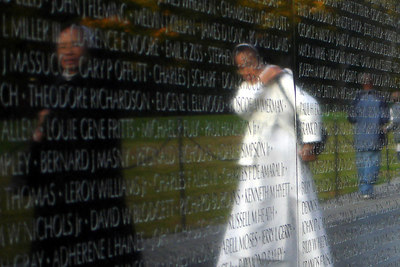 A couple of Vietnamese nuns reflected in the Vietnam Wall - Washington, DC ... October 22, 2006 ... Photo by Rob Page III