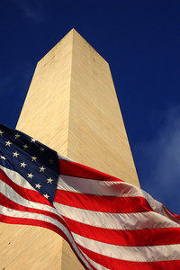The American Flag in front of the Washington Monument - Washington, DC ... October 24, 2006 ... Photo by Rob Page III