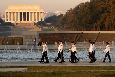 The World War II Memorial with the Lincoln Memorial in the background on Veteran's Day - Washington, DC ... November 11, 2006 ... Photo by Rob Page III