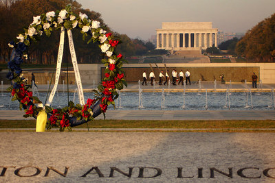 The World War II Memorial with World War II Veterans paying respect to their fallen comrades on Veteran's Day - Washington, DC ... November 11, 2006 ... Photo by Rob Page III
