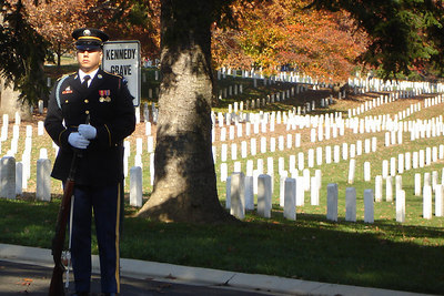 A soldier at Arlington National Cemetary on Veteran's Day - Washington, DC ... November 11, 2006 ... Photo by Rob Page III