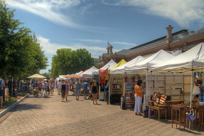 People browse for local arts, crafts, food, and goods at the Eastern Market in Washington, D.C. on Saturday, August 15, 2015. Copyright 2015 Jason Barnette