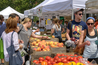 People browse through the produce at the Dupont Circle FRESHFARM Market, a farmers' market with produce and baked goods from local farms, located at 20th Street NW in Dupont Circle in Washington, DC,  on Sunday, August 17, 2014. Copyright 2014 Jason Barnette